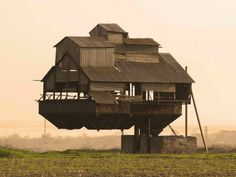 Floating Castle (Ukraine)  Supported by a single cantilever, this mysterious levitating farm house belongs in a sci-fi flick.  Gravity-Defying Homes From Around the World