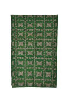 This Totito Wool Rug is carefully handmade by a skilled team of master weaver artisans using a pedal loom. This piece is inspired by local spanish houses located in Guatemala City. A great accent piece!