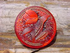 czech glass button in red with tulip