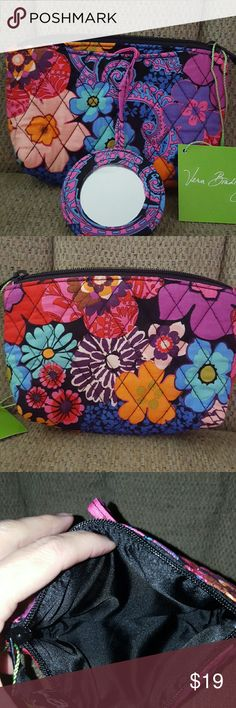 "VERA BRADLEY MIRROR COSMETIC BAG New with tags.   In pattern  FLORAL FIESTA   SMALL COSMETIC BAG with a front pocket that has attached cosmetic mirror.  7"" wide x 4 1/2"" tall Vera Bradley Bags Cosmetic Bags & Cases"