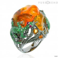 """Lydia Courteille / Ring  """"Jardin de Xochimilco"""" - black gold, 4 rubies, 196 green garnets and 15 fire opals from Mexico."""