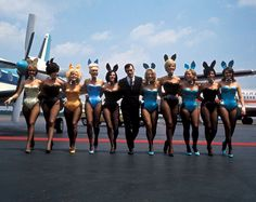"""THE CAPTAIN HAS TURNED OFF THE """"NO DÉCOLLETAGE"""" SIGN Hugh Hefner and several employees on the tarmac in Los Angeles following the opening of that city's Playboy Club, 1965. Vanity Fair, Vintage Photos, Vintage Love, Vintage Beauty, Vintage Stuff, Bunnies, Bunny Bunny, Easter Bunny, Happy Easter"""