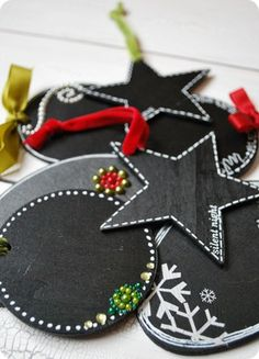 Chalkboard gift tags:paint generic cheap wood shapes from the craft store with black chalkboard paint punch a hole near the edge of each shape (the Cropadile cuts them like buttah!) Add magnetic back for more use