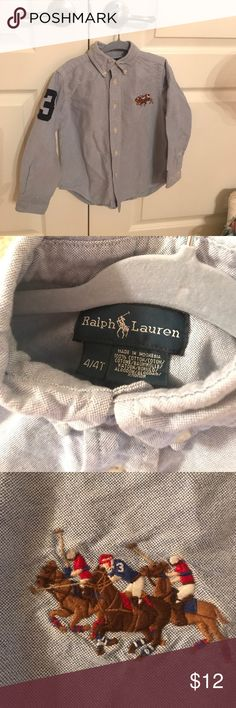 Ralph Lauren chambray button down shirt size 4 Seize 4 Ralph Lauren light blue 100% cotton chambray button down shirt. Very good used condition, no stains I can see. Cute logo on chest and number 3 on right shoulder. Ralph Lauren Shirts & Tops Button Down Shirts