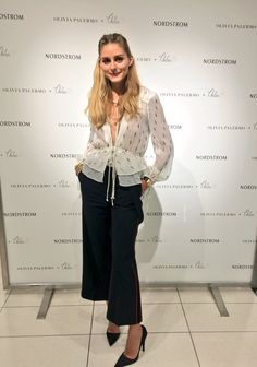 Olivia Palermo at the presentation of Chelsea28 Nordstrom collection: white seventies print chiffon blouse, wide-legged pants, heels