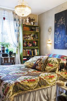 Zinat Pirzadehs bedroom with bedspreads bought in Milan.  It also houses desk and bookcase.