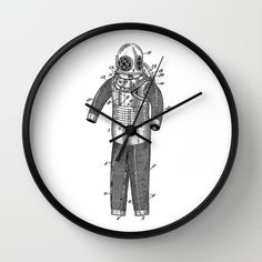 "Diving Suit Patent Clock, diving suit man Patent Clock, Modern Clock, The diving suit man Clock, Spacesuit  clock, diving suit man clock by STANLEYprintHOUSE  47.00 USD  Available in natural wood, black or white frames, our 10"" diameter unique Wall Clocks feature a high-impact plexiglass crystal face and a backside hook for easy hanging. Choose black or white hands to match your wall clock frame and art design choice. Clock sits 1.75"" deep and requi ..  https://www.etsy.com/ca/list.."