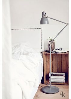 Wooden crate as a bedside table