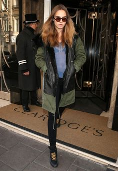 Cara Delevingne wears her Mr and Mrs Italy military parka with a sheer top, skinny jeans and sneakers.