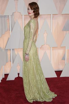 The Oscar-Night Looks That Won, Big Time  #refinery29  http://www.refinery29.com/2015/02/82608/oscars-2015-best-dressed-red-carpet-photos#slide-12  Has Emma Stone ever made a red-carpet misstep? If she has, we've never seen it. This year's Oscars brought another opportunity for her to show she can pull anything off — even a long-sleeve, low-back, fully bejeweled Elie Saab gown.