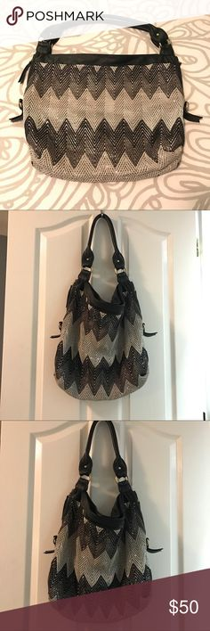 Big Buddha Slouch Bag This large Big Buddha slouch bag is super cute and very spacious. Black, silver and gray design makes it easy to wear with almost any color. Can be worn as a day or night bag. The outside is in good condition, and inside has some pillage but is otherwise in good condition as well. Big Buddha Bags Hobos