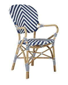 A classic 1930s European bistro chair, reinterpreted and elevated to new heights. Handcrafted of sustainable rattan and woven plastic seats, it's great for the kitchen or the patio. Look closely and you'll notice the wonderfully organic marks created while bending and stretching the rattan into shape – a time-honored technique perfected by the French. The eye-catching palette makes it easy to work with. Try it with the other silhouettes in this collection (a slight variation in how the…