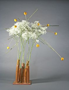 I used a self made ceramic vase and added gypsophilia to give it a look of clouds floating above. When I added the yellow craspedia it had the appearance of lightning bolts shooting outwards.