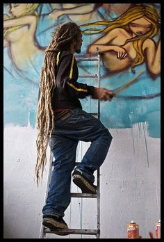 beautiful long dreads! artists express themselves through their hair and their art..