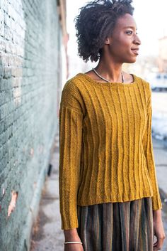 This lightweight pullover features a simple but beautiful texture pattern, created with tuck-stitch columns arranged over a reverse stockinette background. The wide ribbed hem and cuffs align with the columnar motif, as well as the garter stitch neckband which maintains the unbroken line of stitches as it is worked. An empire waist and flared sillhouette …