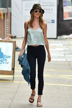 Hats Off: The Best Celebrity Toppers - Behati Prinsloo masters the minimalist trend in slim black jeans, a floaty tank and an army green hat.