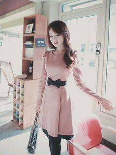 pink coat and bow belt