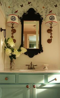 vintage powder room - love the eggshell blue cabinetry, ornate antique mirror, vintage style hardware, and the wall border