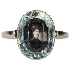 1920s Aquamarine Gold Portrait Locket Ring  | From a unique collection of vintage more rings at https://www.1stdibs.com/jewelry/rings/more-rings/