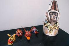 "Guatemalan miniature masks share a surface with ""Monkey in Fez,"" a sculpture from Ardmore Ceramic Art in South Africa. ""I love masks and all kinds of animal imagery,"" Mr. Rockefeller said."