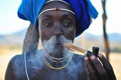 Africa |  'Magic Dragon'  Mukubal woman, South West Angola | © Luca Gargano, via Flickr