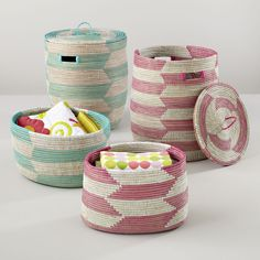 Shop Snake Charmer Storage Baskets.  While these colorful baskets are in fact charming, they're also reminiscent of the classic baskets used by traditional snake charmers.  But don't worry, there's nothing inside them.