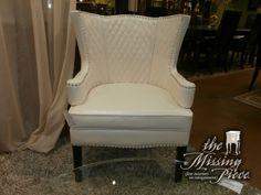 The sleek form, white leather upholstery and wingback of this stylish chair make it a perfect piece of furniture for a unique interior. Beautiful nailhead accents and slender contrasting legs Measures 29*30*38.