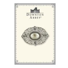 Pearl Perfection. A ladylike lace of silver antiqued filigree is divinely decorated with a creamy ivory cultura pearl center and white diamond round-cut crystals gracing each corner of this opulent oval pin. Pair with any of your favorite frocks for superior sophisticated style. Presented in an elegant Downton-Abbey themed gift box.