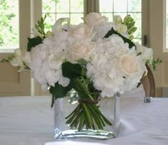 Simple white/ivory centerpieces in clear vases