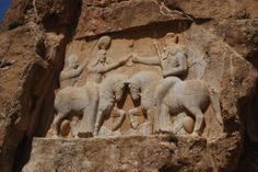 The Investiture of Ardeshir by Ahura Mazda, from Taq-e Bostan. Taq-e Bostan is the site of a series of large rock reliefs from the Sassanid Empire of Persia (226-650 CE), located in the Zagros Mountains in western Iran, along a Silk Road caravan route.