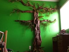 My son wanted an Amazon rain forest room. I made this with brown bulletin board paper & vines from A craft store. We will add shelves just above each branch for his trophies.