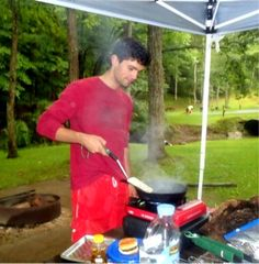 Grandson cooking on our camping trip at Cedar Creek 2015.