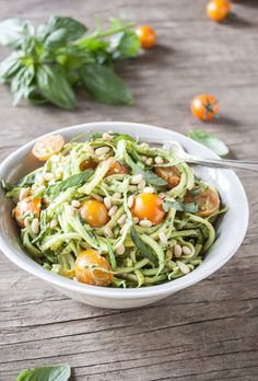 """Zucchini """"pasta"""" with avocado pesto ♡ This dish takes a whopping TEN MINUTES to create!  2 large zucchinis, julienned or spiralized 1 cup cherry tomatoes, sliced in half 1/2 cup pine nuts 1/2 cup fresh basil, julienned salt and pepper ..."""