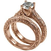"""Solid 14k Rose Gold """"Infinity"""" design Hand Crafted Engagement Ring and matching fitted Wedding Band."""
