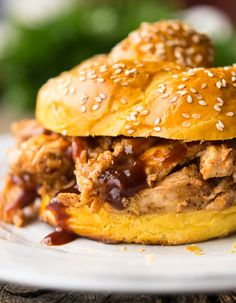 Our pulled chicken slow cooker recipe is super easy with a sweet and spicy tang that makes the perfect weeknight meal time and time again. Pulled Chicken Sandwiches, Slow Cooker Recipes, Crockpot Meals, Freezer Meals, Crock Pot Cooking, Sweet And Spicy, Slow Cooker Chicken, Chicken Recipes, Ethnic Recipes