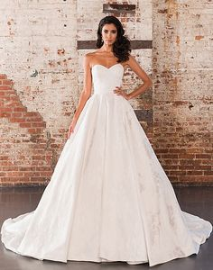 Beauty lies within the subtle details of this organza ball gown with allover lace appliqués, a sweetheart neckline, natural waist, and monarch length train.