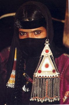 "Saudi Arabia |  Veiled woman, no other details provided form the source BUT a pinner living in Saudi added ""this seems typical adornment of the Qasim Region. Showed this to a Saudi friend and she said that she thinks so too. Great photo, very few such traditional Bedouin women left here now."""