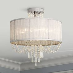 This silver organza shade and chrome ceiling light features clear crystal beads that radiate when illuminated. Shade is 19 wide x high. Canopy is 6 wide. Takes six maximum 60 watt type B candelabra bulbs (not included). Style # at Lamps Plus. Crystal Ceiling Light, Ceiling Light Fixtures, Lamp Light, Wall Lights, Ceiling Lights, Globe Chandelier, Candelabra Bulbs, Luxury Lighting, Bedroom Lighting