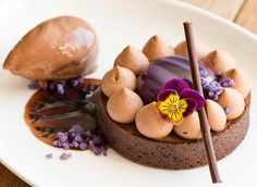 """This stunning """"Chocolate & Violet Tart"""" from Pastry Sous Chef Noelle Gogg @noelleeyygee92 is now on the menu of @ballantynehotel """"Chocolate Tart Shell, Violet & Valrhona BAHIBE 46% Mousse, Valrhona ILLANKA 63% Cremeux, BAHIBE 46% Chantilly, ILLANKA 63% Violet Sorbet, Crystallized Violet Petals"""""""