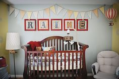 Handmade Eclectic Nursery on COUTUREcolorado Baby with hot air balloons, pennant flags, and DIY name wall art.