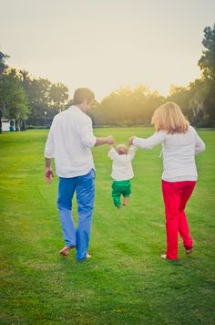 6 month #baby photo shoot, sunset, colored pants, white shirts, golf course, family, holding hands, carrying baby