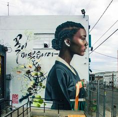 "Christian ""Royal Dog"" Chanyang Shim is a Korean graffiti writer who has been creating murals featuring black women in traditional Korean hanbok. 