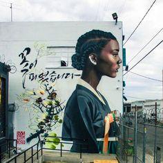 "Christian ""Royal Dog"" Chanyang Shim is a Korean graffiti writer who has been creating murals featuring black women in traditional Korean hanbok. | This Man Painted Black Women In Traditional Korean Hanbok And It's Beautiful"
