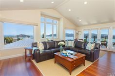 Beautiful living room with wraparound views. Tour the rest of this home on www.fhallen.com.