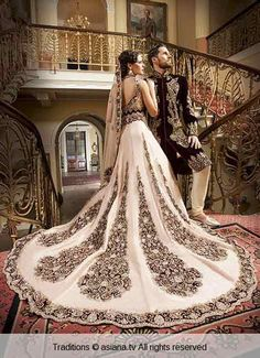Bridal in long tail white embroidered lehnga choli and groom in matching sherwani latest indian and pakistani wedding matching dress combinations for bride and groom 2017