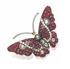 RUBY AND DIAMOND BUTTERFLY BROOCH.  Mounted en tremblant, the winged insect decorated throughout with numerous round and cushion-shaped rubies and rose-cut diamonds, the eyes and tips of the antennae set with small round green stones, mounted in silver and gold.