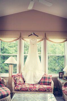 Dress on display // Photo by Angeli. #minneapolisweddingphotographer #weddingdress
