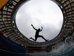 August 13, 2013. Paul Kipsiele Koech of Kenya jumps a water obstacle in the men's 3000 metres steeplechase heat during the IAAF World Athletics Championships at the Luzhniki Stadium in Moscow.