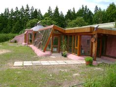 Earthship house. No more electric bills, water bills, heat bills. Greenhouse along the entire front of the house.
