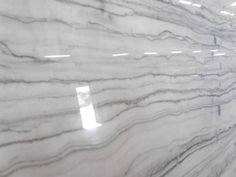 White Macaubus Quartzite (almost as hard as diamonds, does not etch, stain, etc.)